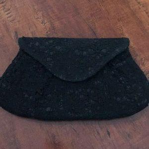Lauren Merkin lace clutch